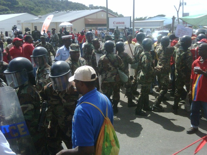 Riot Police clearing the entrance of the Grenada Breweries Limited