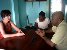 Tourism Minister Peter David meets with Oscar Bartholomew's wife and mother