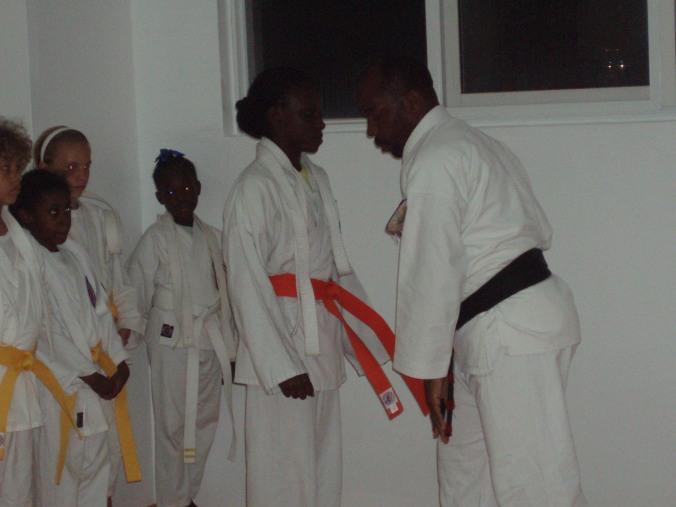 Danielle Bartholomew receiving her orange belt